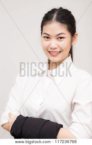 Smiling Asian Caucasian Business Woman.