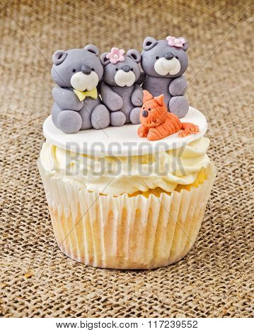 Cupcake With Teddy Bear Family On Rustic Jute Background