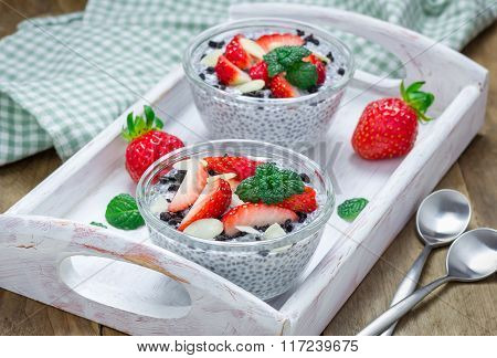 Chia Seed Pudding With Strawberries, Almond And Chocolate Cookie Crumbs