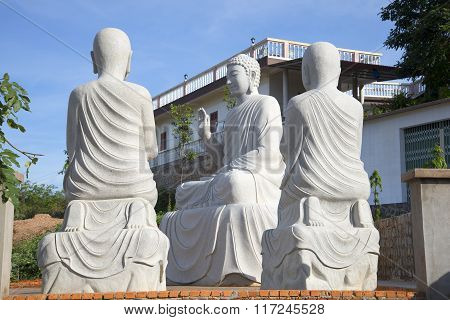 Buddha with two disciples. Sculptural composition. Phan Thiet, Vietnam