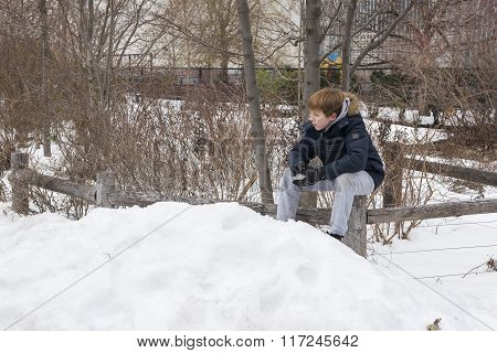 Young boy holding a snowball