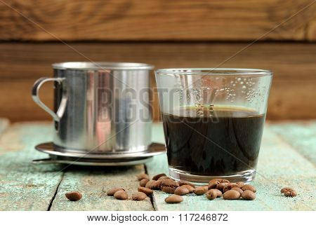 Vietnamese Coffee Brewed In French Drip Filter On Turquoise Wooden Table