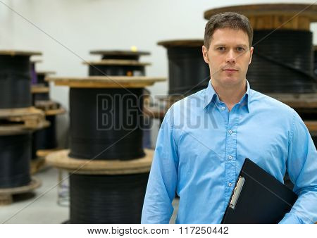 Handsome manager at electrical wire and cable factory.