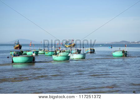 Fleet round plastic boats after fishing in the Fishing harbour of Mui Ne. Vietnam