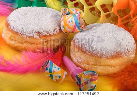 Traditional german sweet berliner doughnut with Carnival decoration