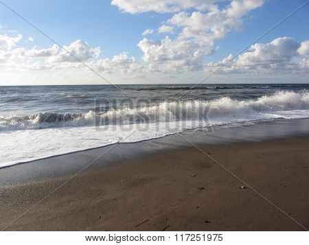 Wave Of The Sea On The Sand Beach. Castiglione Della Pescaia, Province Of Grosseto, Italy