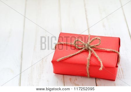 Red Box Gift On White Wooden Table