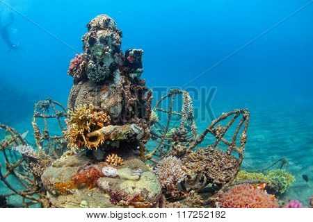 Underwater Buddha Statue With Diving Snorkeler On The Background