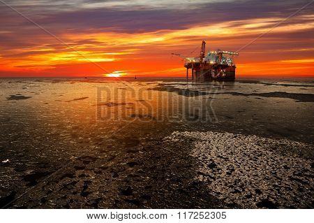 Oil Drilling Rig At Sea In Winter