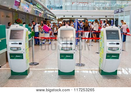 ROME, ITALY - AUGUST 16, 2015: self check-in kiosks in Fiumicino Airport. Fiumicino - Leonardo da Vinci International Airport is a major international airport in Rome, Italy