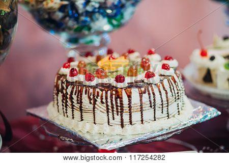 chocolate cake with cherries and whipped cream