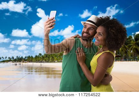 Young couple taking a selfie photo on the beach