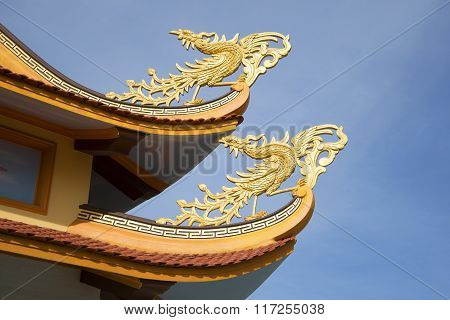 Fabulous birds on the curves of the roof of a Buddhist pagoda