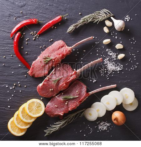 Raw Beef Steaks With Ingredients On A Slate Closeup. Background Top View
