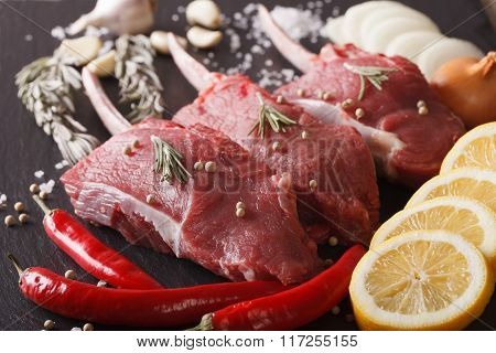 Raw Beef Steak With Spices On A Stone Table Closeup. Horizontal