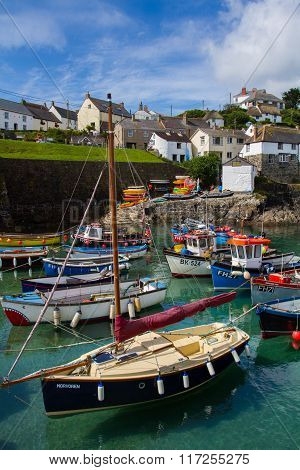 COVERACK, CORNWALL, UK - JUNE 12, 2015  An example of a typical Cornish fishing village showing a harbour full of fishing boats and yachts with the village in the background.