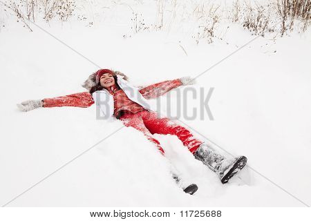 Woman Lying On  Snow