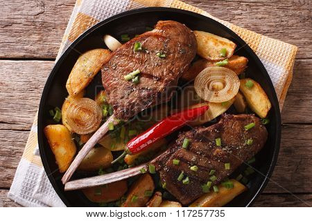 Beef Steak With Chili And Fried Potatoes Closeup. Horizontal Top View