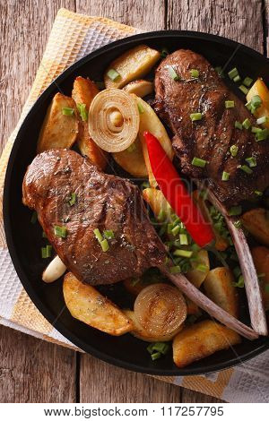 Beef Steak With Chili And Fried Potatoes Close-up. Vertical Top View
