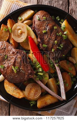 Grilled Beef Steak And Fried Potatoes Close Up On A Plate. Vertical Top View