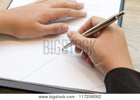 Close Up Of Businesswoman Signing A Contract