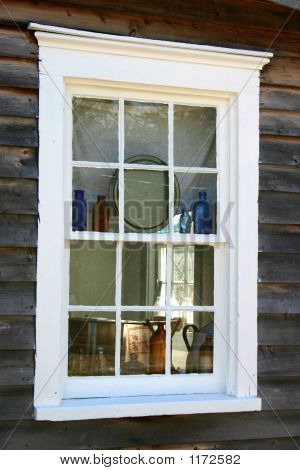 Colonial Window Displaying Bottles