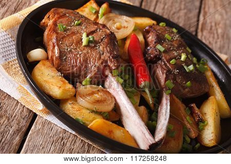Beef Steak With Chili And Fried Potatoes Close-up. Horizontal