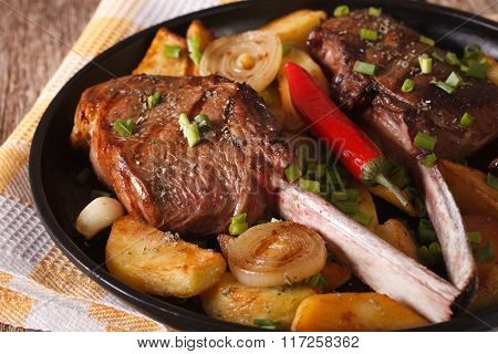 Spicy Beef Steak With Fried Potatoes On A Plate Close-up. Horizontal