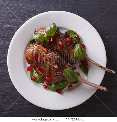 Grilled Beef Steak With Pomegranate And Basil Close-up. View From Above