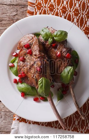 Grilled Beef Steak With Pomegranate And Basil Close-up. Vertical Top View