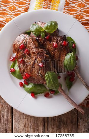 Grilled Beef Steak With Pomegranate Closeup On A Plate. Vertical Top View