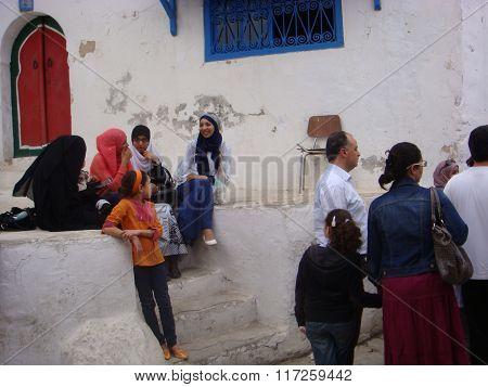Sidi Bou Said, Tunisia - May 11, 2013. Teens Communicate On The Street
