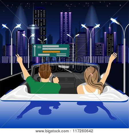 happy free couple driving in cabriolet car in night city cheering joyful with arms raised