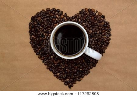 Hearts Shaped Coffee Beans And A Cup Of Coffee