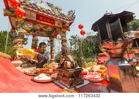 KOH CHANG, THAILAND - JAN 7, 2016: Unidentified participants during the celebration Chinese New Year in Koh Chang Chinese temple. Now begins 4714 year according traditional lunisolar Chinese calendar.