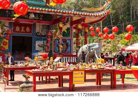 KOH CHANG, THAILAND - JAN 7, 2016: Chinese New Year celebration at the Chinese temple. 4714 year (traditional lunisolar Chinese calendar) begins February 8, characters: Monkey, fire, red.