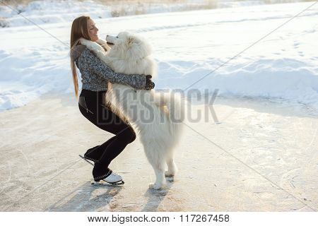 young Figure skating woman with dog Samoyed