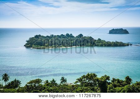 Remote  tropical island in turquoise colored transparent sea