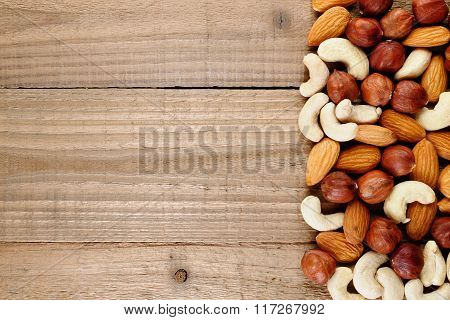 Hazelnuts, Almonds And Cashew Nuts On Wooden Table Top View