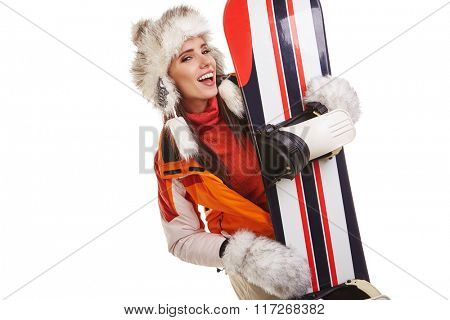 Woman standing with snowboard isolated on white