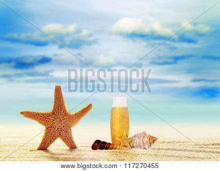 Starfish, seashell and suntan cream on sand beach with ocean