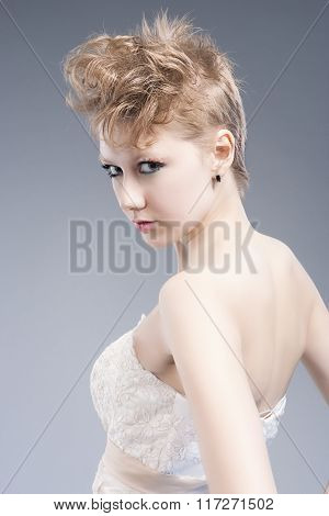 Beauty And Fashion Concepts. Young Sexy Blond Woman In Nicely Tailored Wedding Dress Posing Against
