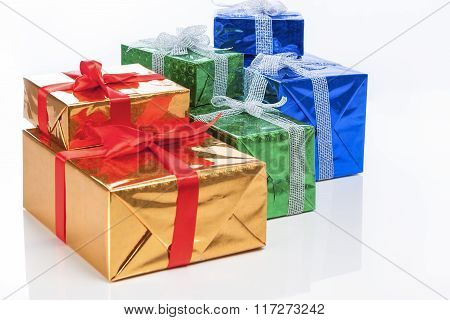 Presents And Celebration Concepts. Many Colorful Wrapped Up Gift Boxes Standing In Line Together. Is
