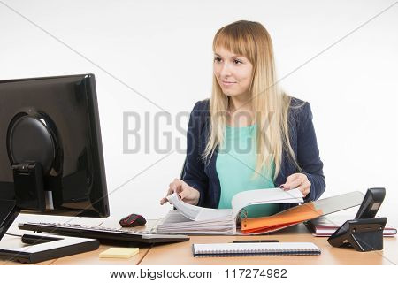 Office Specialist Leafing Through Paper Documents Folder Looked Into The Computer