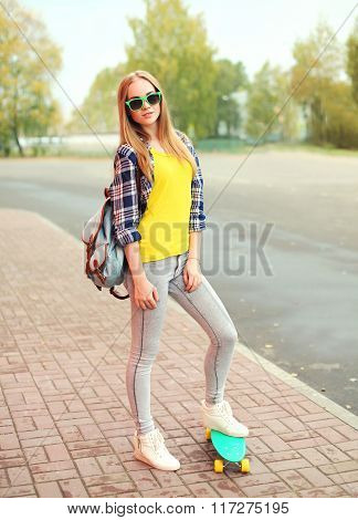 Fashion Pretty Blonde Girl With Skateboard Posing In City