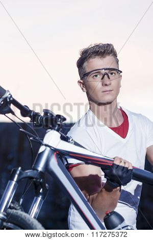 Cycling Concept And Ideas. Handsome Sportive Caucasian Cyclist With Mtb Bike Outdoors.