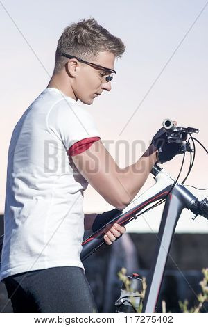 Cycling Concept And Ideas. Handsome Sportive Caucasian Cyclist With Mtb Bike Outdoors