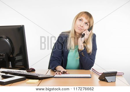 Angry Business Woman Talking On The Phone And Looking Up