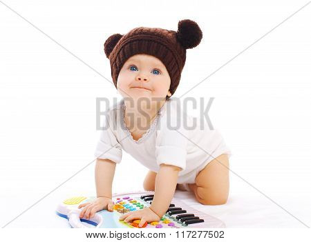 Baby Playing With Toy Piano On A White Background