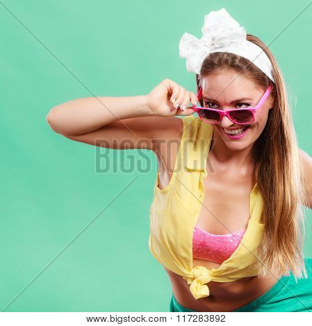 Portrait Of Happy Pin Up Girl Wearing Sunglasses.